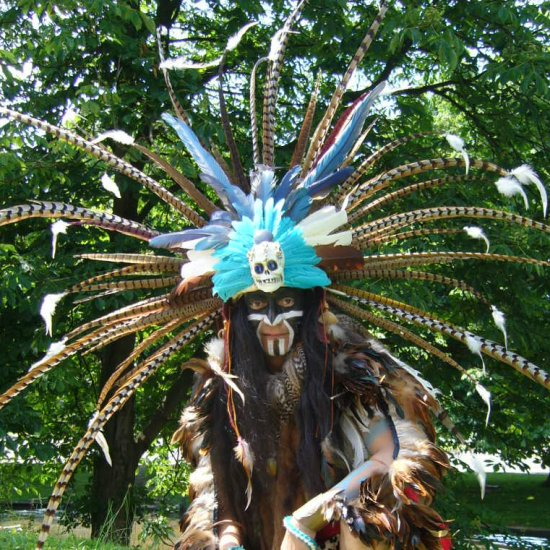 A Maya storyteller with authentic headdress.